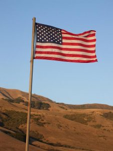 Photo of American flag on desert landscape