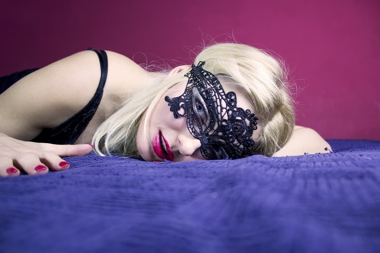 Photo of a sexy, masked woman.