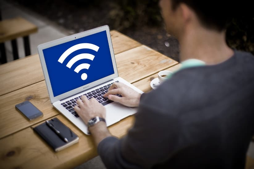 Photo of person using laptop on WiFi