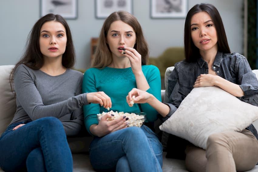 3 women watching a show